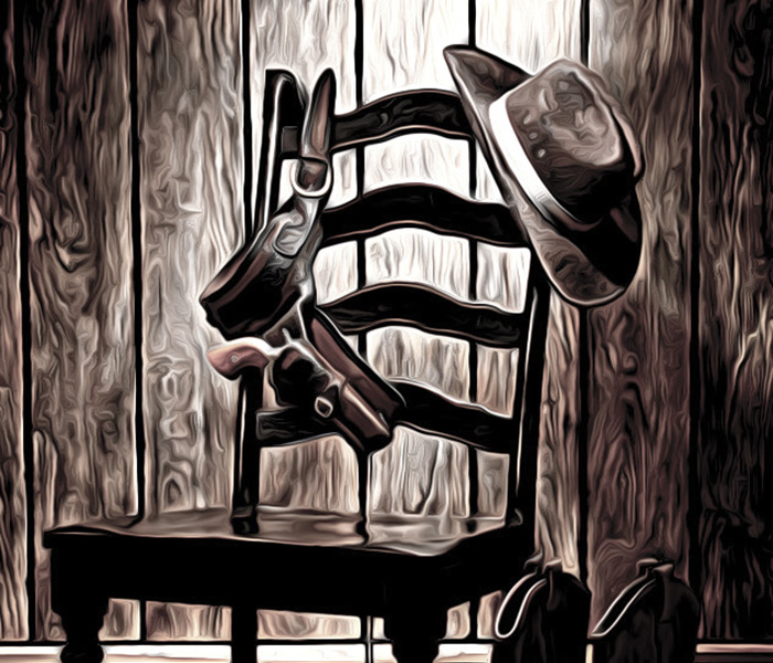 American West Legend Cowboy Hat and Gun on Chair